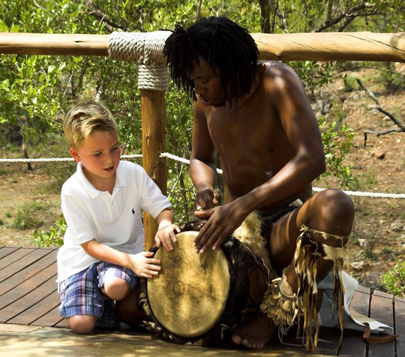 royal-madikwe-kids-club-Drummer-with-Kid-at-Xmas