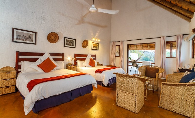 Thatched_Garden_Suite_Teak_Bedroom-2