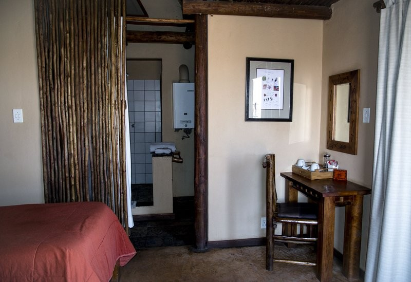 xaus-lodge-accommodation-room-interior-desk-entrance-bathroom