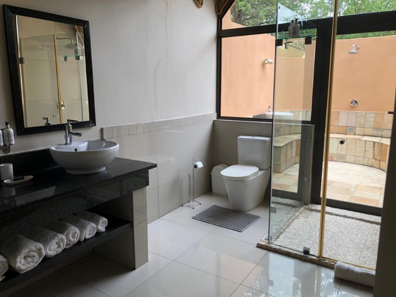 impala-bathroom-from-basin-to-shower-to-outside