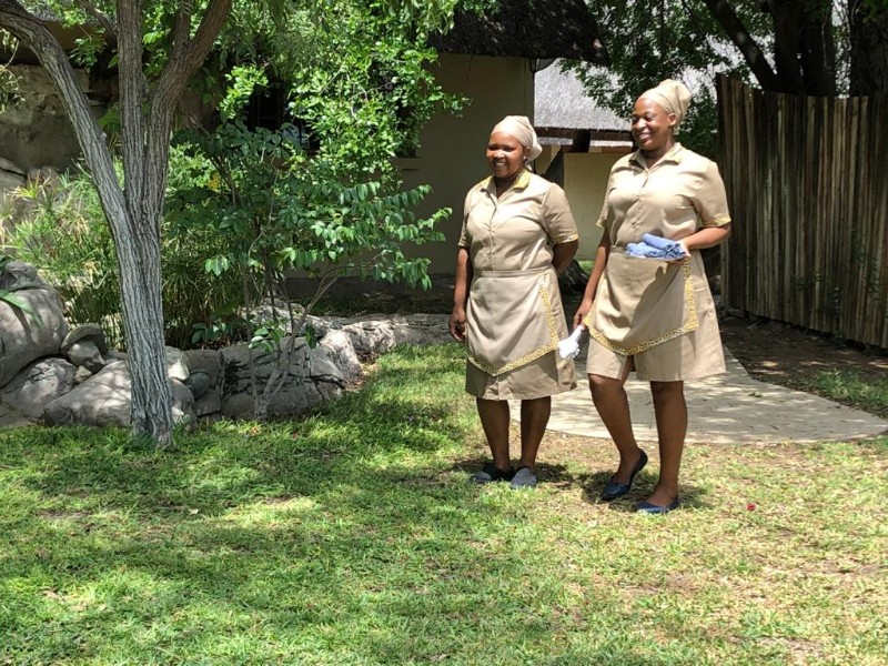 kwenga-staff-ladies-on-the-way-to-welcome-guests
