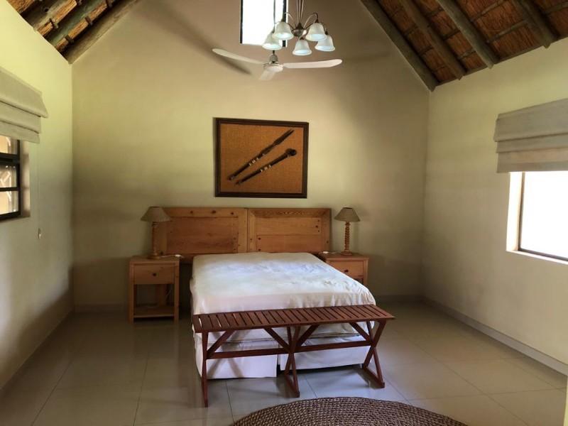 kwenga-standard-room-towards-bed-from-bathroom-door